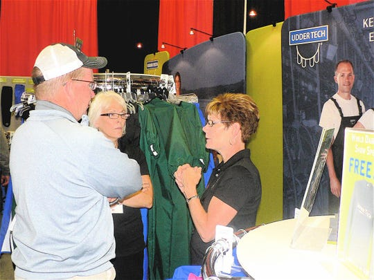 """Cheryl Mohn (right) remembers her first Dairy Expo 24 years ago when as a dairy farmer/Home Ec teacher, she introduced her new company  """"Udder Tech"""" that is now worldwide."""