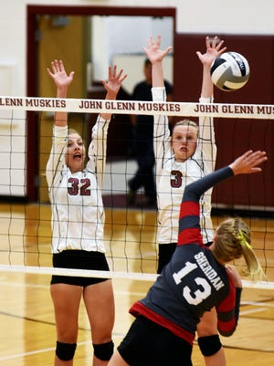John Glenn's Lyndi Slack, left, and Kenzie Knellinger go up for a block against Sheridan's Erin Schultz during the fourth game of the Muskies' 25-20, 25-20, 6-25, 29-27 win on Tuesday night.