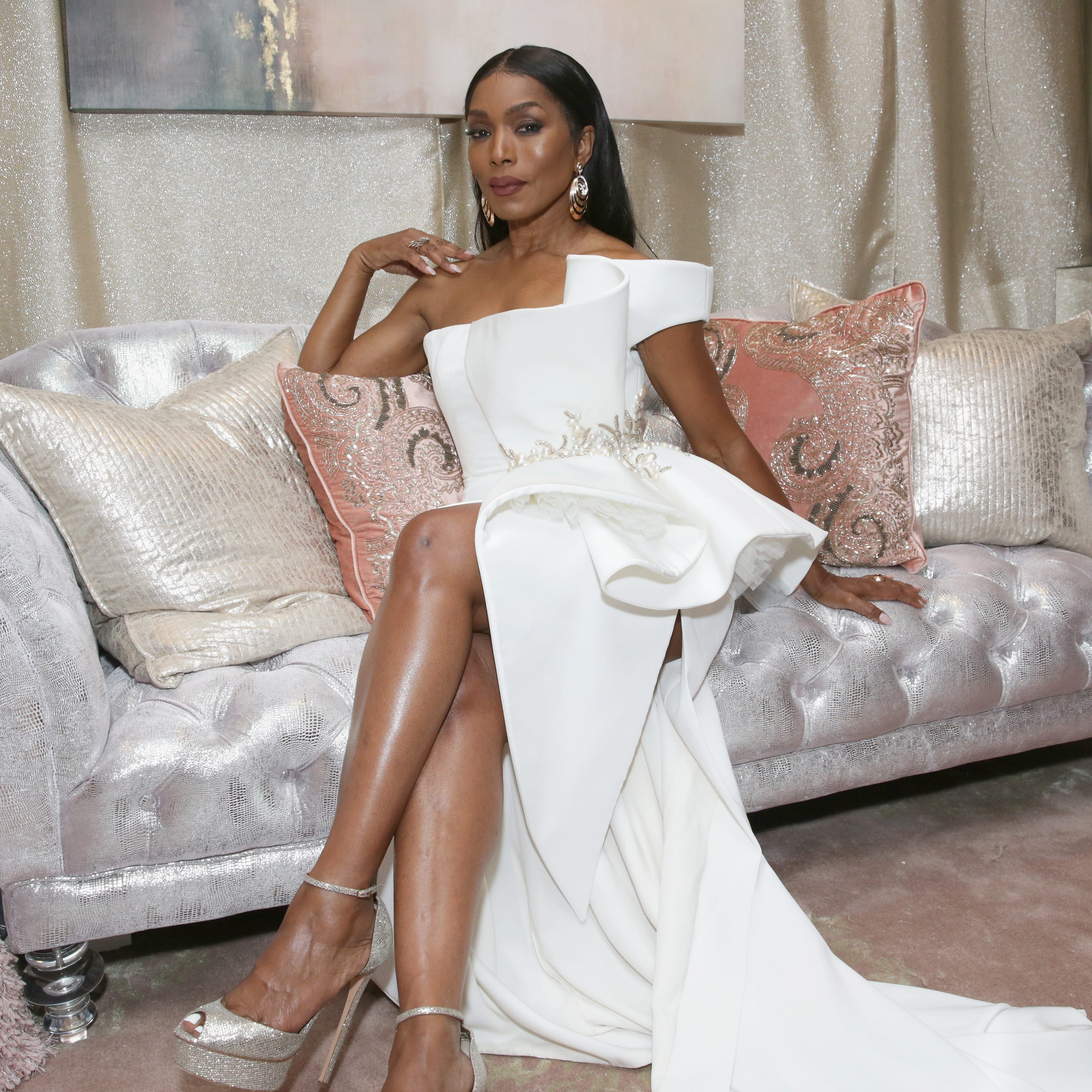 'No worries!': Angela Bassett lets New York Times' Omarosa Manigault Newman mix-up slide
