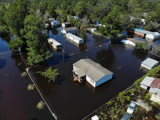 Flood waters isolate homes in the aftermath of Hurricane Florence Sept. 19, 2018, in Lumberton, N.C.