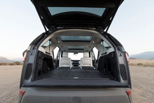 This undated photo provided by Edmunds, shows the 2018 Land Rover Discovery, which allows you to remotely fold the rear seats flat via a linked smartphone app. (Courtesy of Edmunds.com Inc. via AP)