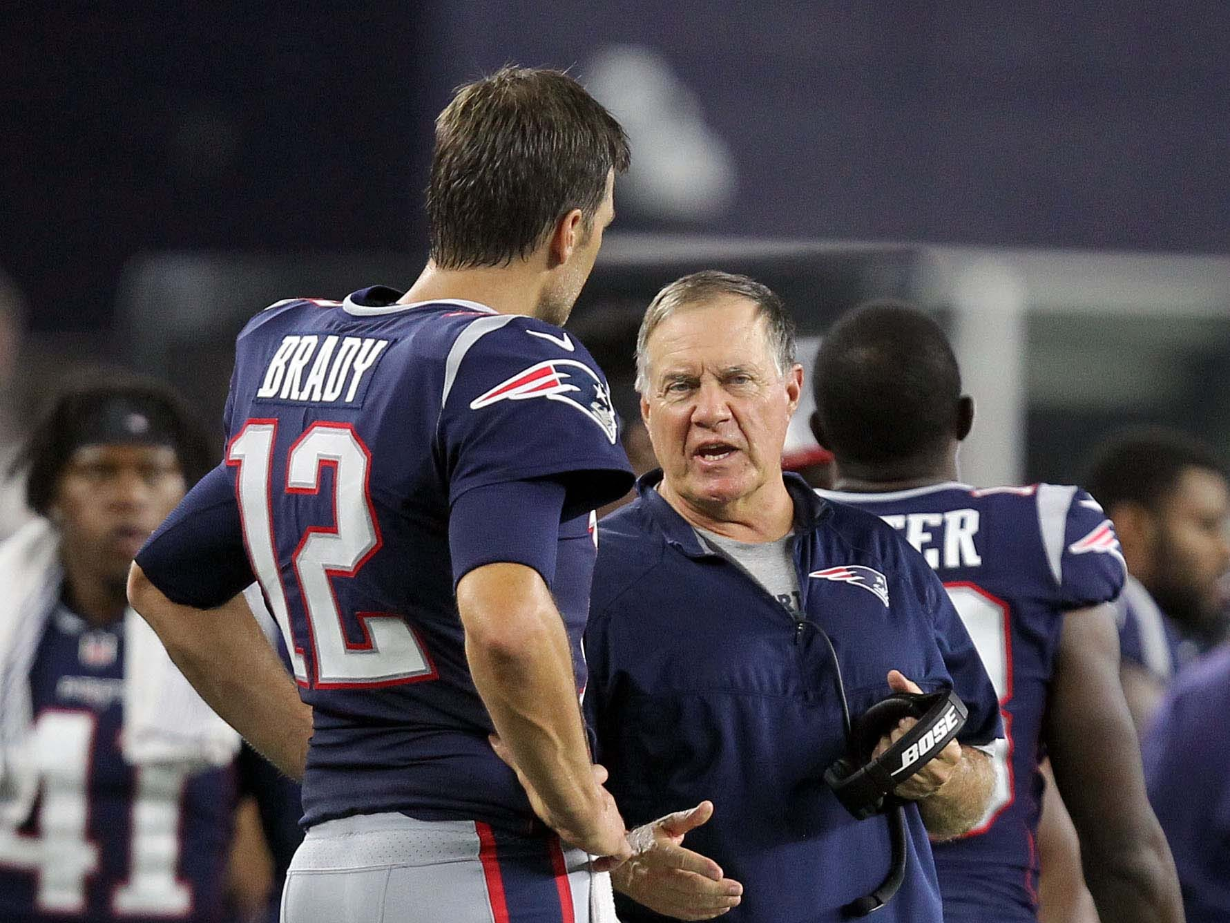 Patriots head coach Bill Belichick talks with quarterback Tom Brady during the fourth quarter against the Philadelphia Eagles at Gillette Stadium during the preseason.