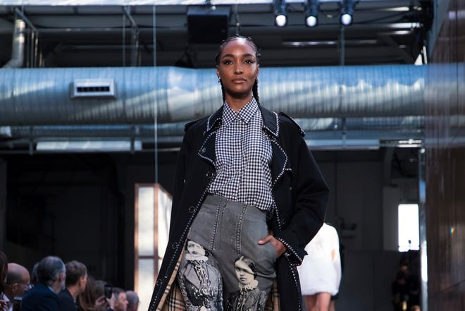Model Jourdan Dunn wears a creation by Burberry during their Spring/Summer 2019 runway show at London Fashion Week in London, Monday, Sept. 17, 2018.