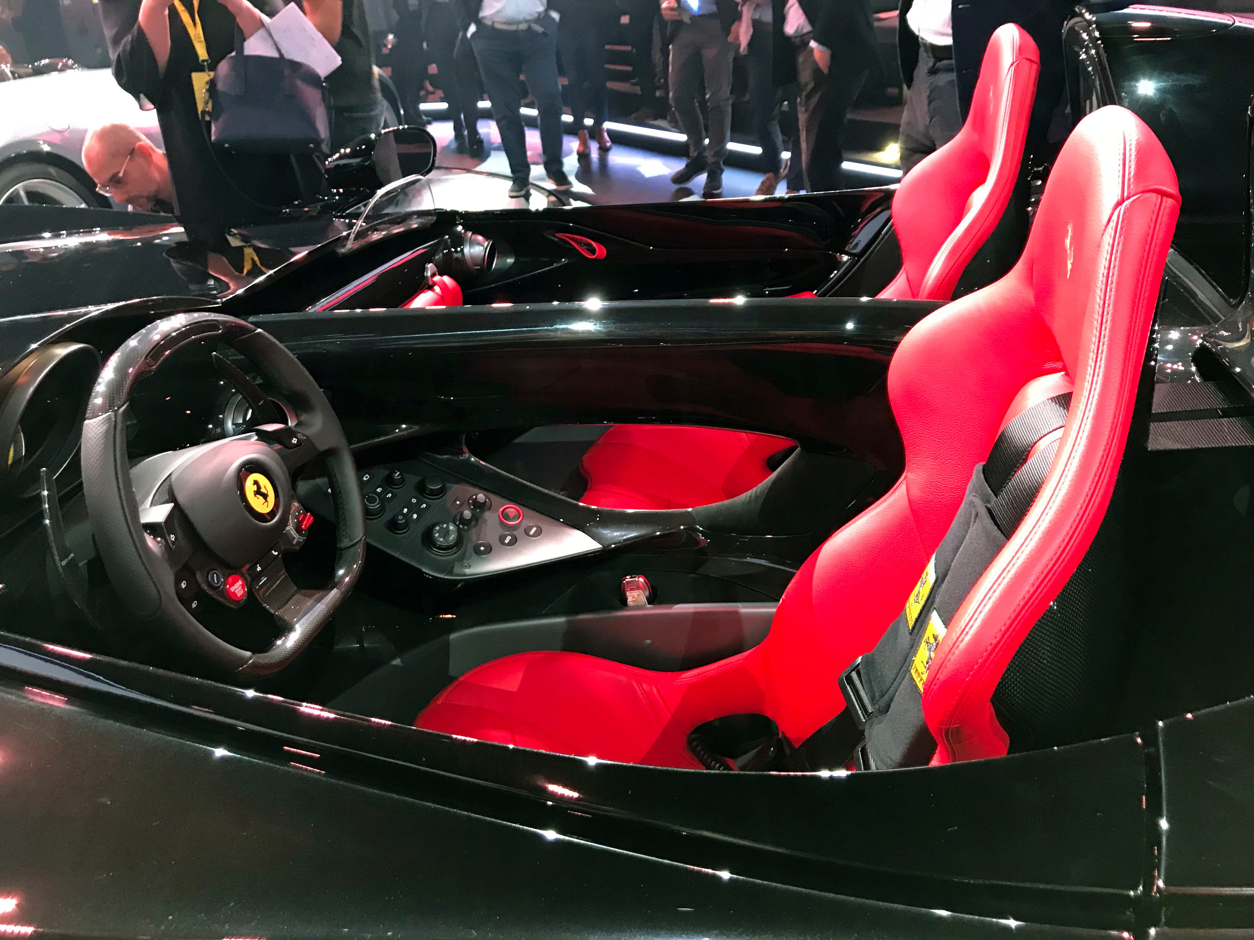 """The Ferrari Monza SP2 is displayed in Maranello, Italy, Tuesday, Sept. 18, 2018. Sportscar maker Ferrari has unveiled two updated versions of its classic open-top """"barchetta"""" racing model as it briefs investors on a new five-year business plan."""