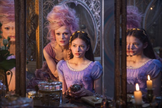 "Keira Knightley serves major look in a wig, prosthetic purple eyebrows and glittery lashes as the Sugar Plum Fairy opposite Mackenzie Foy in November's ""The Nutcracker and the Four Realms."""
