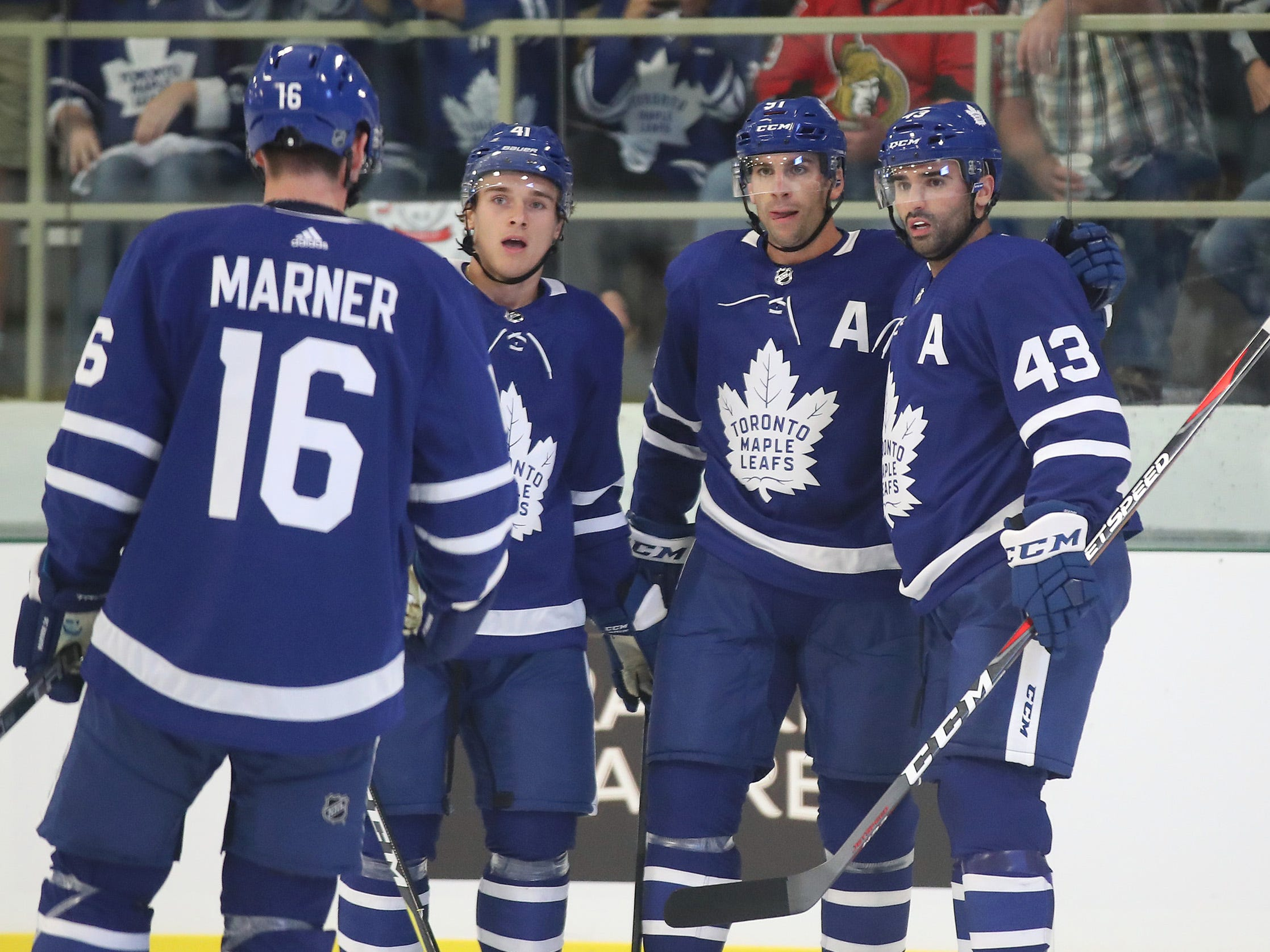 Toronto Maple Leafs center John Tavares (second from right) celebrates with teammates after scoring a goal in the first period against the Ottawa Senators.
