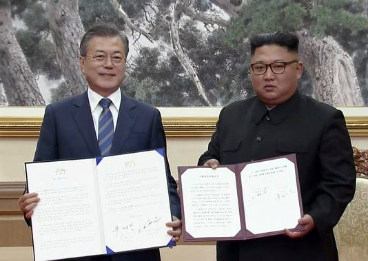 In This Image Made From Video Provided By Korea Broadcasting System Kbs South Korean President Moon Jae In Left And North Korean Leader Kim Jong Un
