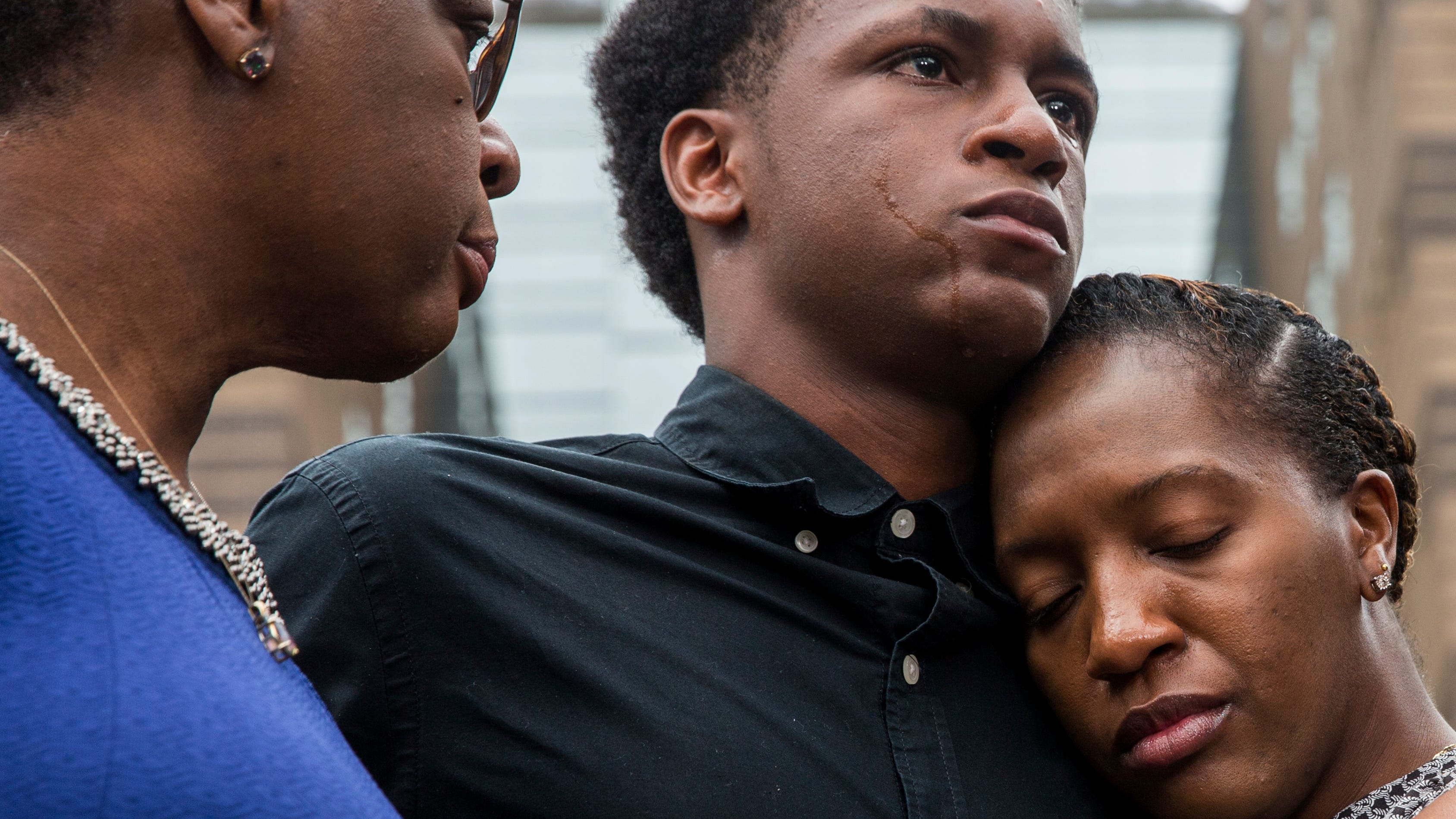 Brandt Jean, brother of Botham Jean, is comforted by his sister, Allisa Charles-Findley, as their mother, Allison, looks on during a news conference on Sept. 10, 2018.