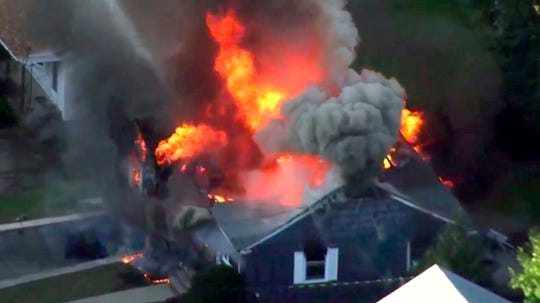 In this image take from video provided by WCVB in Boston, flames consume a home in Lawrence, Mass, a suburb of Boston, on Sept. 13.