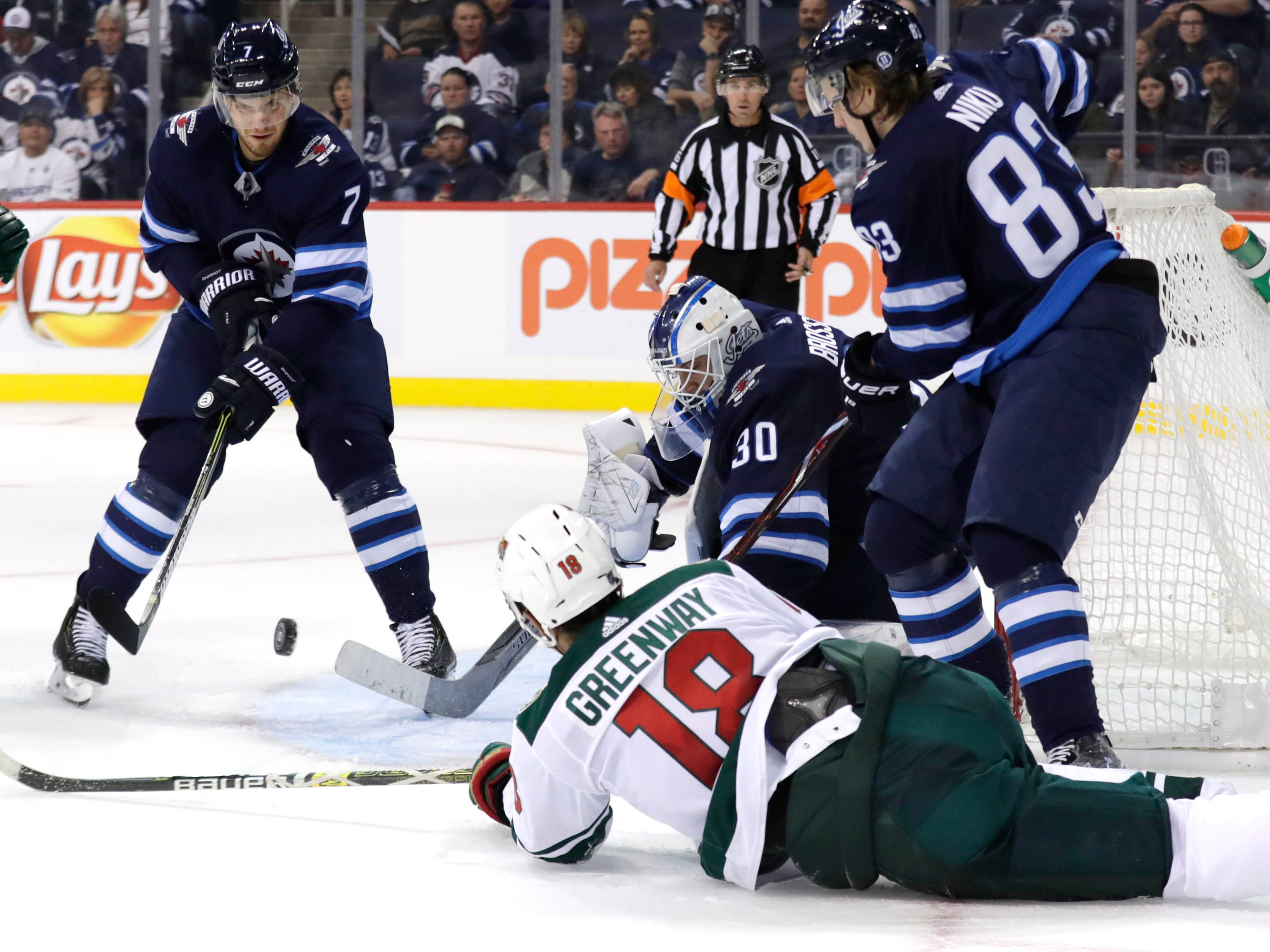 Sept. 17: Minnesota Wild left wing Jordan Greenway trips in front of Winnipeg Jets goaltender Laurent Brossoit.