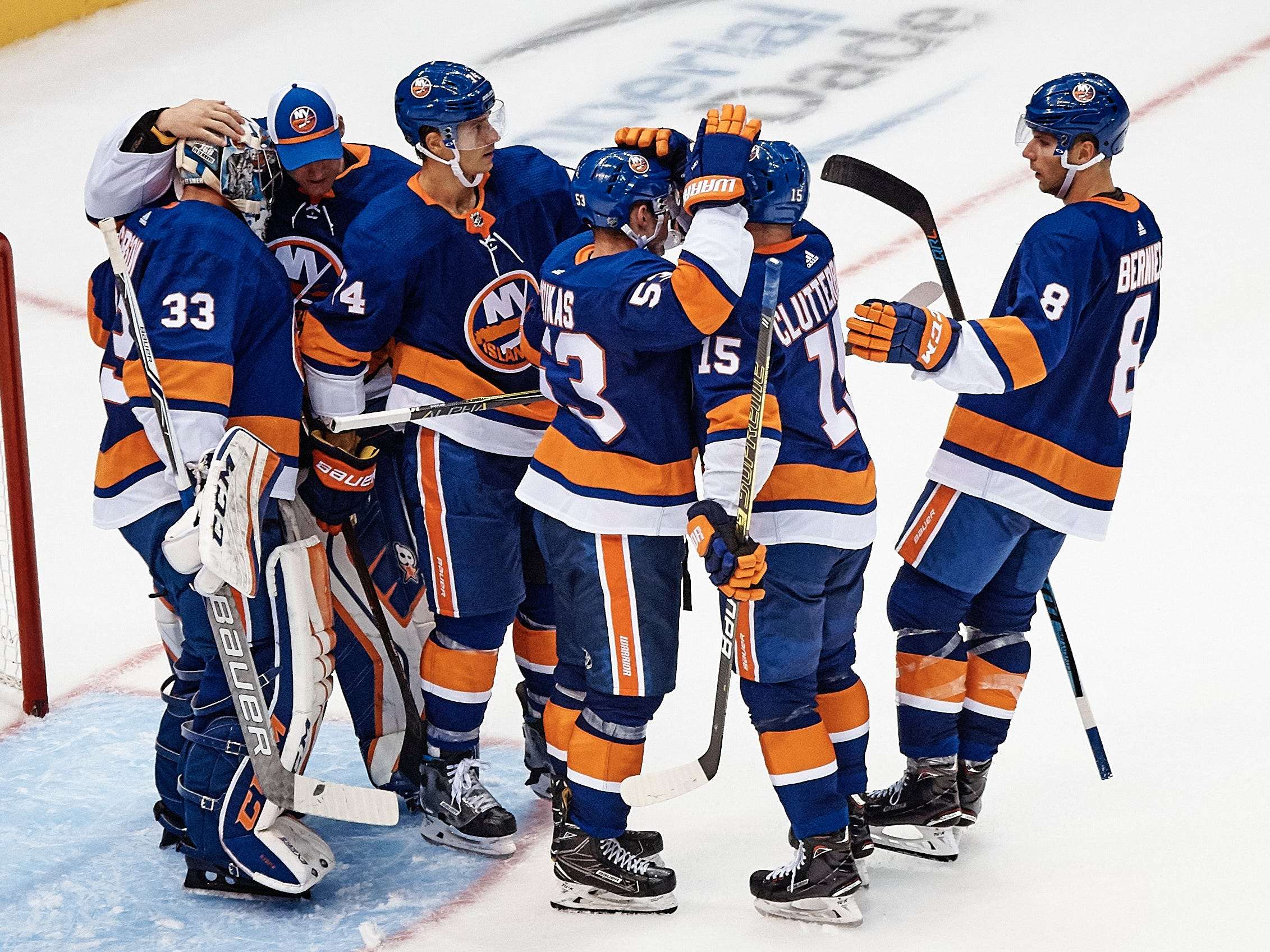 Sept. 16: New York Islanders players celebrate their victory against the Philadelphia Flyers.