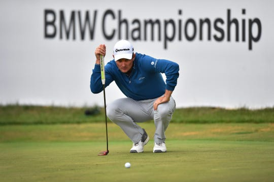 Justin Rose reads his putt on the 18th  green during the third round of the BMW Championship on Sept. 8.