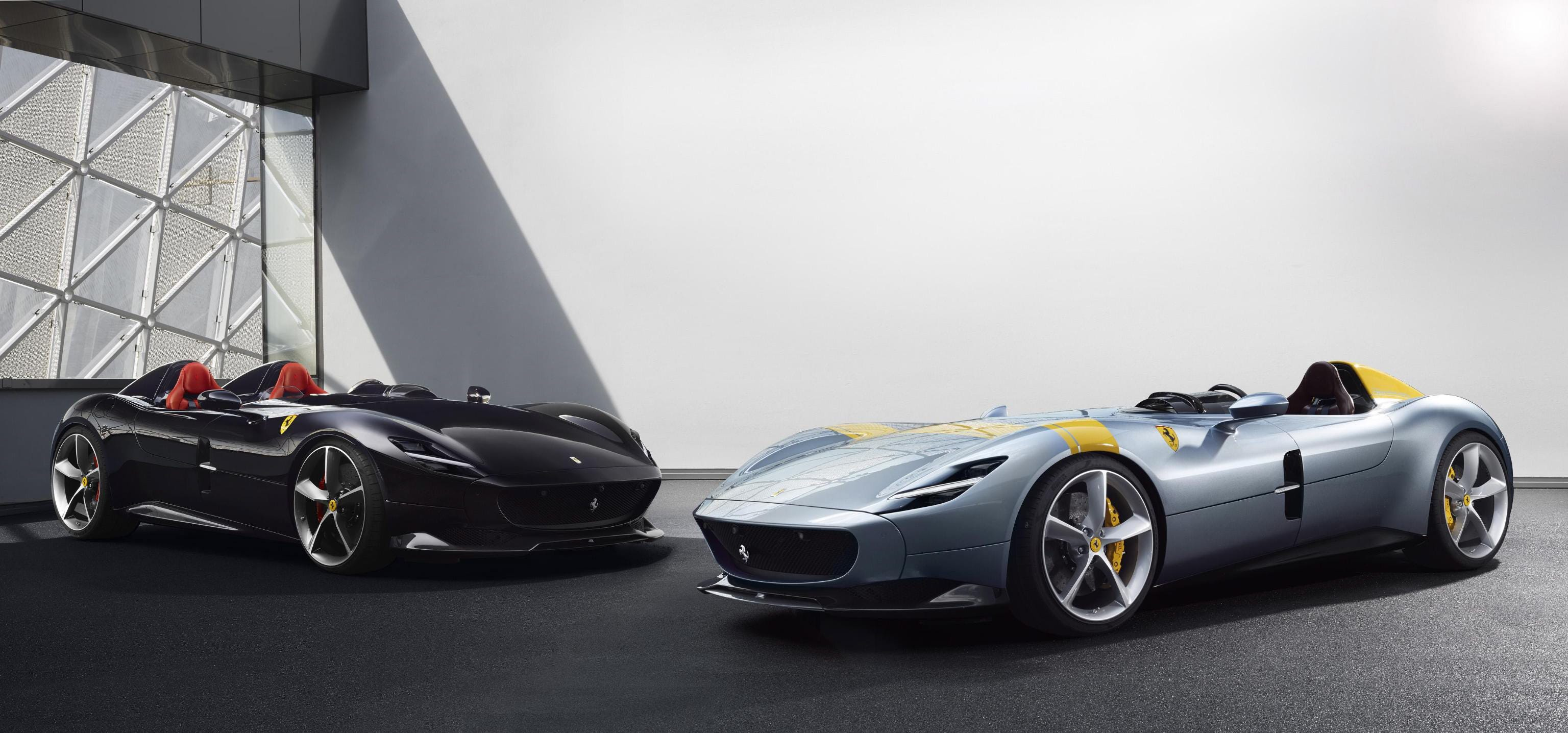 A photo made available by the Ferrari Press Office shows new supercar Ferrari  SP1, right, and SP2 on display in Maranello, Italy on Sept. 18, 2018. Ferrari will launch 15 new models between 2019 and 2020 and then its eagerly anticipated Purosangue (Thoroughbred) SUV in 2022, the Italian glamour sportscar maker said on  September 18.