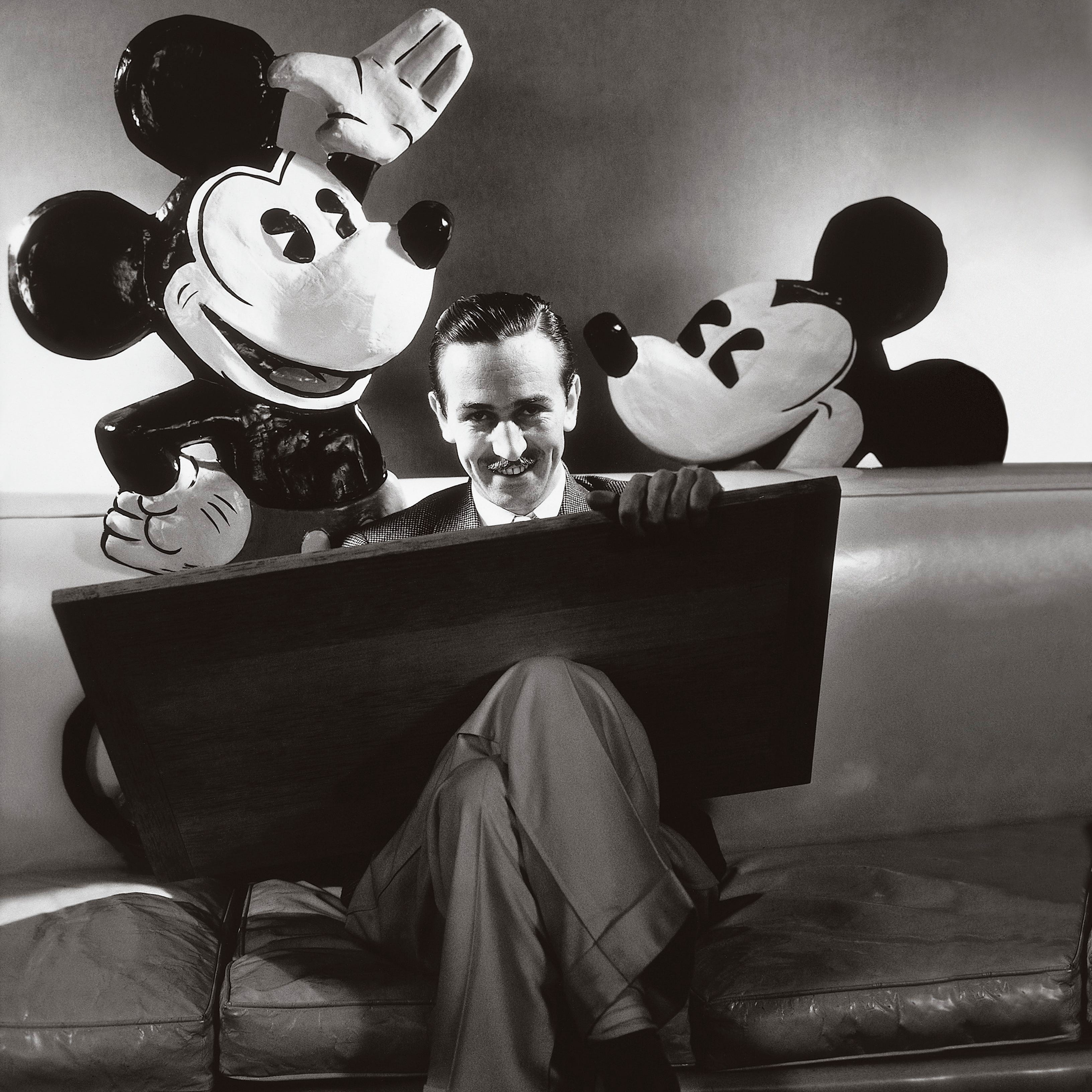 Walt Disney in October 1933 with a drawing board and flanked by representations of his creations, Mickey and Minnie Mouse. Disney's life was chronicled in a 'American Experience' documentary on PBS.