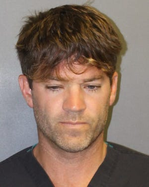 A booking image released by the Orange County District Attorney's Office showing Grant William Robicheaux, 38. He was arrested and charged for allegedly sexually assaulting two women by use of drugs, in Newport Beach, California.