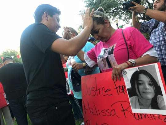 Members of Melissa Ramirez's family pray during a candlelight vigil in Laredo on Tuesday, Sept. 18. Ramirez was the first of four women allegedly slain by Border Patrol agent Juan David Ortiz, on Sept. 3.