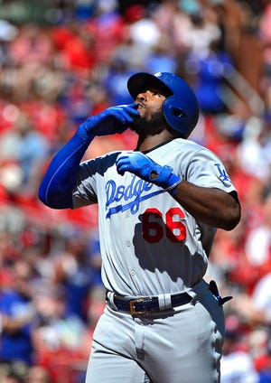 Los Angeles Dodgers right fielder Yasiel Puig (66) celebrates after hitting a solo home run off of St. Louis Cardinals starting pitcher John Gant (not pictured) during the fourth inning at Busch Stadium.
