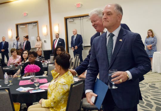 Gov. John Bel Edwards (front) and state representative for District 29 Jay Luneau (back) arrive at the Central Louisiana Regional Chamber of Commerce's 6th annual Women in Business Conference held Thursday at the Holiday Inn in downtown Alexandria where Edwards addressed the crowd.