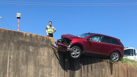 A car teetered on the ledge of a drainage ditch Thursday morning in Alexandria, but nobody was injured.