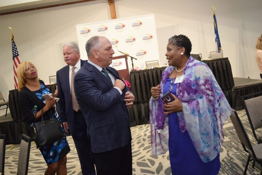 Angie Jackson-Wilson (right), state treasurer for the Louisiana Federation of Business & Professional Women, talks with Gov. John Bel Edwards after Edwards spoke at the Central Louisiana Regional Chamber of Commerce's 6th annual Women in Business Conference held Thursday at the Holiday Inn in downtown Alexandria.
