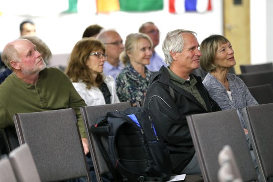 A crowd listens Wednesday as Matthew Soerens, U.S. Director of Church Mobilization for World Relief, talks about his work with immigrants and refugees. The Neenah native spoke during a presentation at Refuge Church in Appleton.