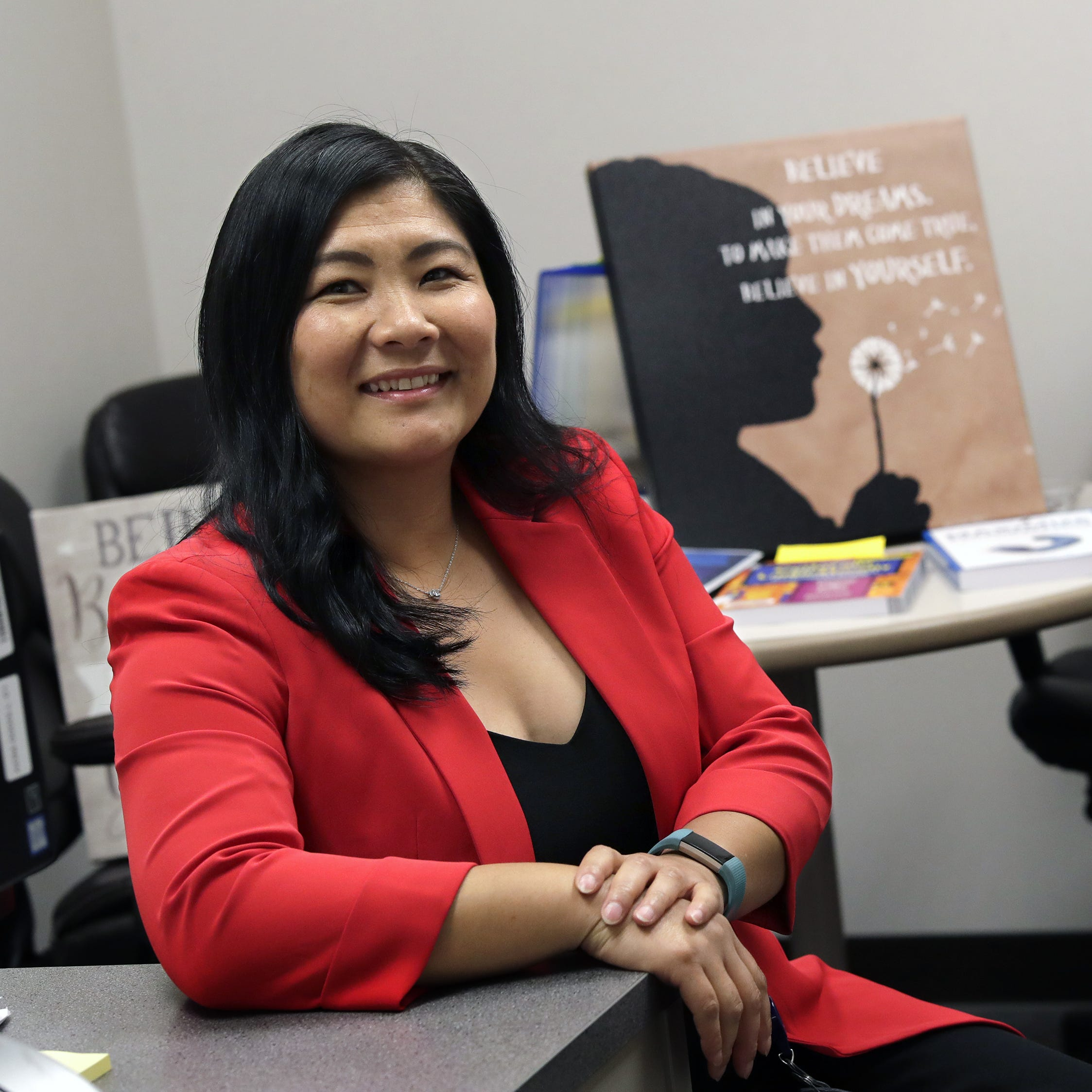 Pa Lee Moua is the new diversity, equity and inclusion officer with the Appleton Area School District. She is seen here in her new office Tuesday, Sept. 18, 2018, at City Center East in Appleton, Wis.  Dan Powers/USA TODAY NETWORK-Wisconsin