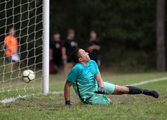 Toms River South goalie Jalen Folsom guesses wrong on a penalty kick by Jackson Memorial's Joe Schlageter who drains it for his second goal of game. Toms River South Boys Soccer vs Jackson Memorial in Jackson, NJ on September 20, 2018.