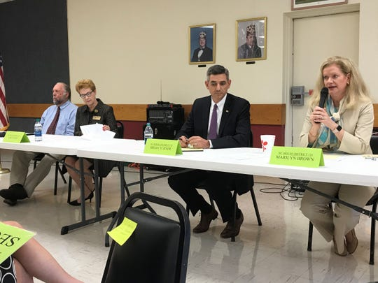 Republican Marilyn Brown, right, speaks during a legislative candidate debate Thursday. Listening are, from the right, Rep. John Ager, Amy Evans, and Rep. Brian Turner.