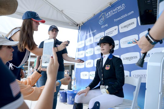 American Angela Peavy talks with members of the media after her performance in the Para-dressage event of the FEI World Equestrian Games at the Tryon International Equestrian Center on Sept. 20, 2018.