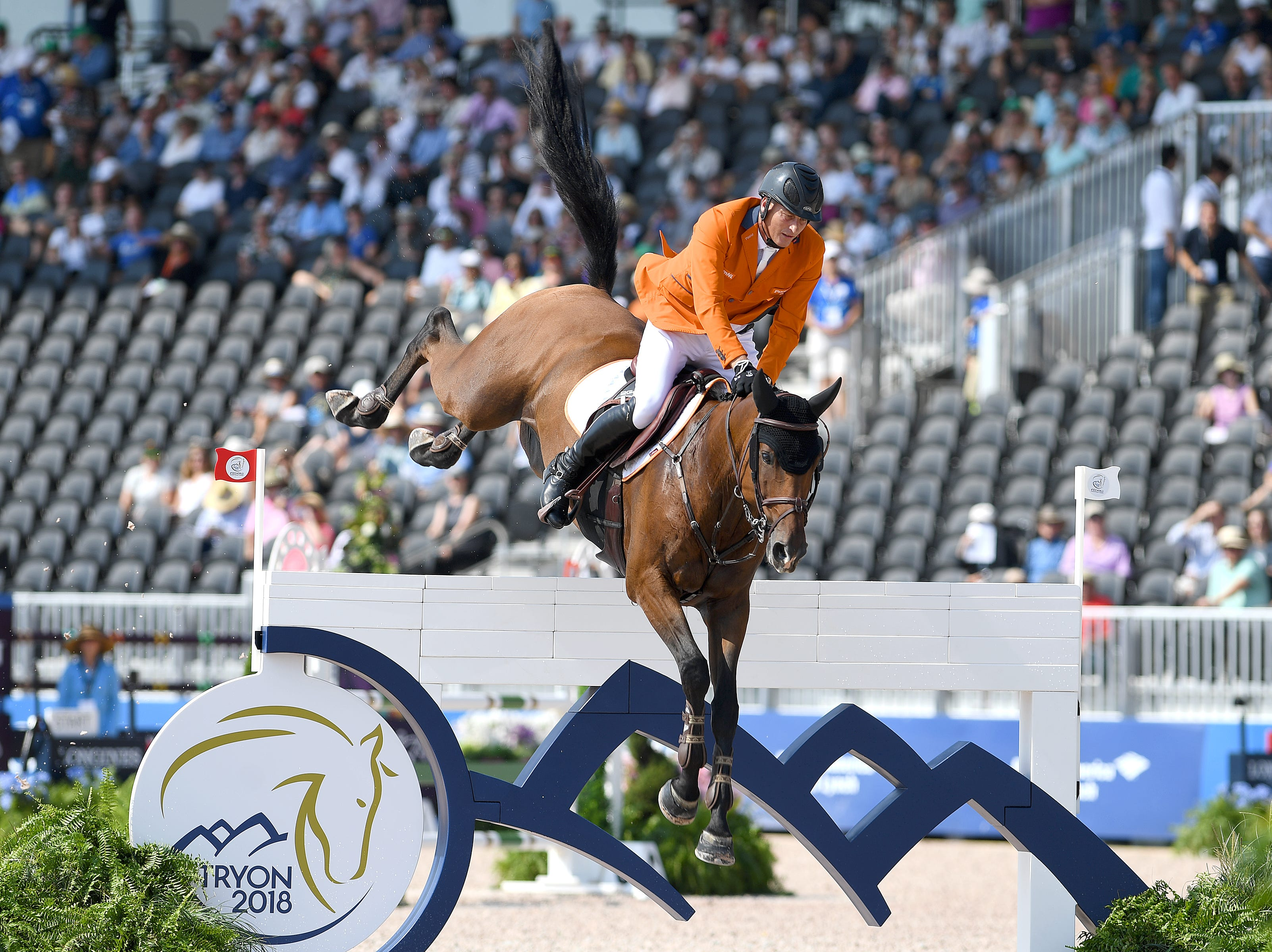 Marc Houtzager, of the Netherlands, on Sterrehof's Calimero, competes in the team jumping competition of the FEI World Equestrian Games at the Tryon International Equestrian Center on Sept. 20, 2018.