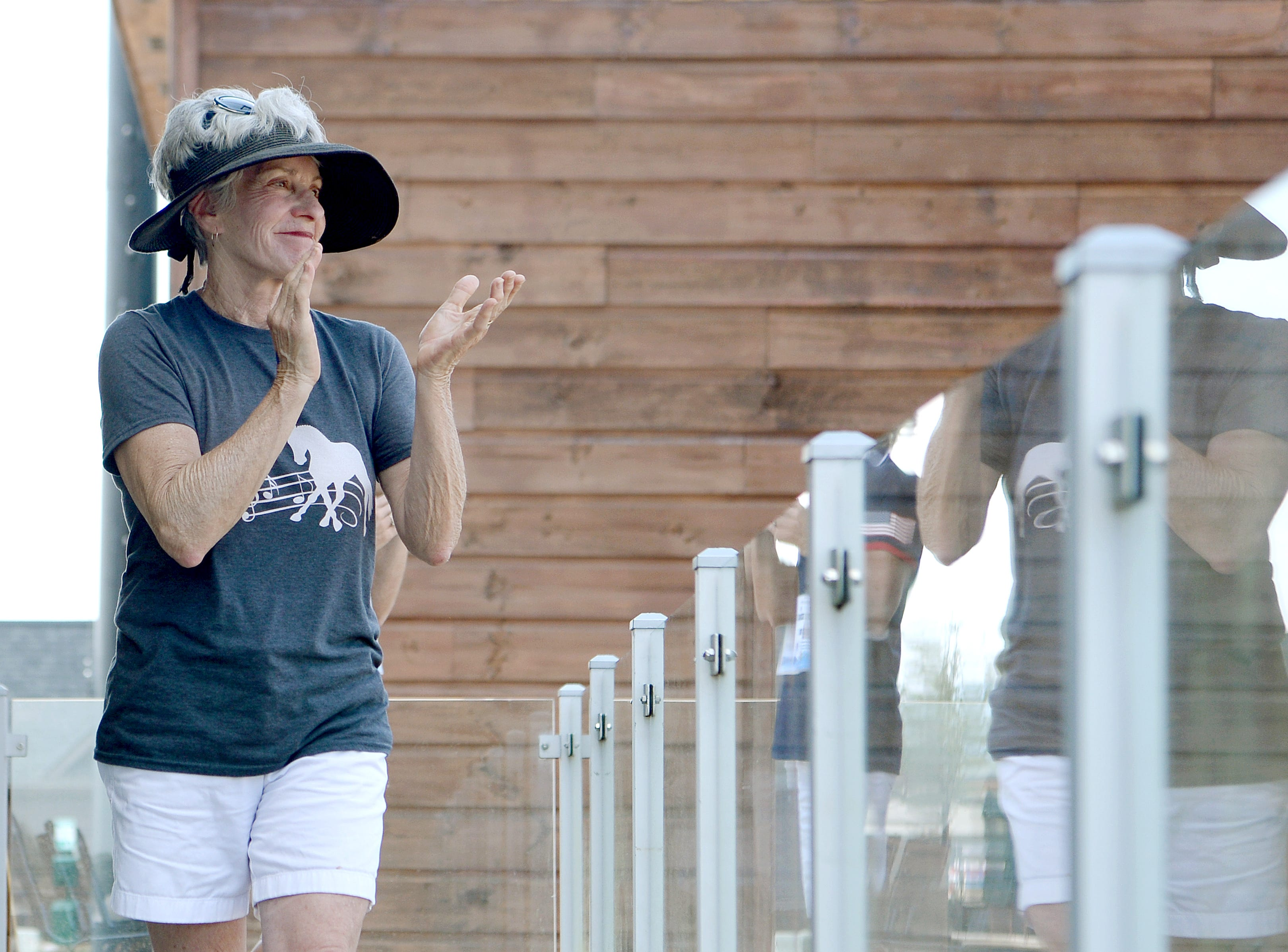 Marlene Whitaker, of Fairview, applauds for American Angela Peavy after her performance in the Para-dressage event of the FEI World Equestrian Games at the Tryon International Equestrian Center on Sept. 20, 2018. Whitaker created the choreography for Peavy's freestyle competition.