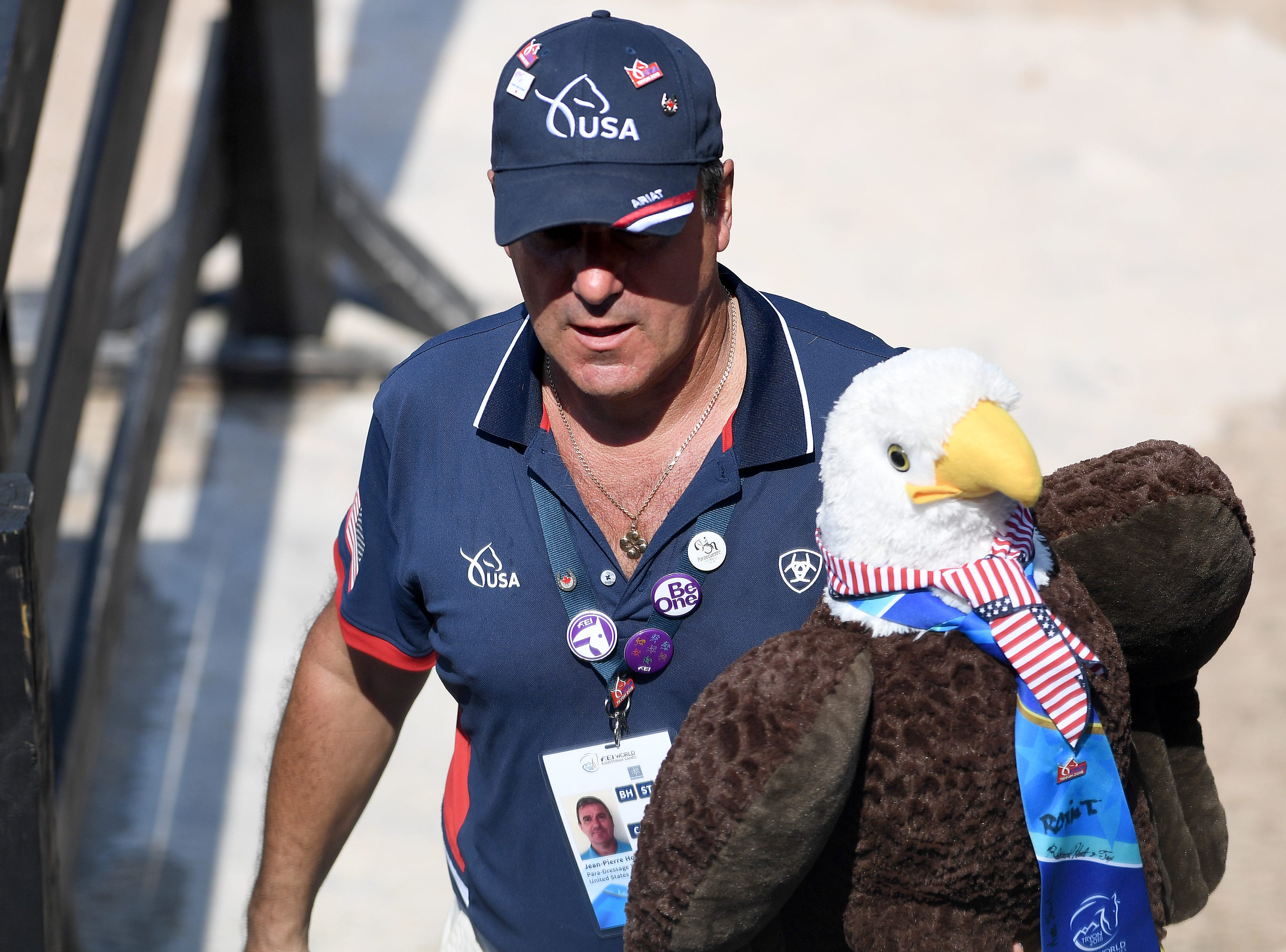 An American carries a stuffed bald eagle during the Para-dressage competition of the FEI World Equestrian Games at the Tryon International Equestrian Center on Sept. 20, 2018.