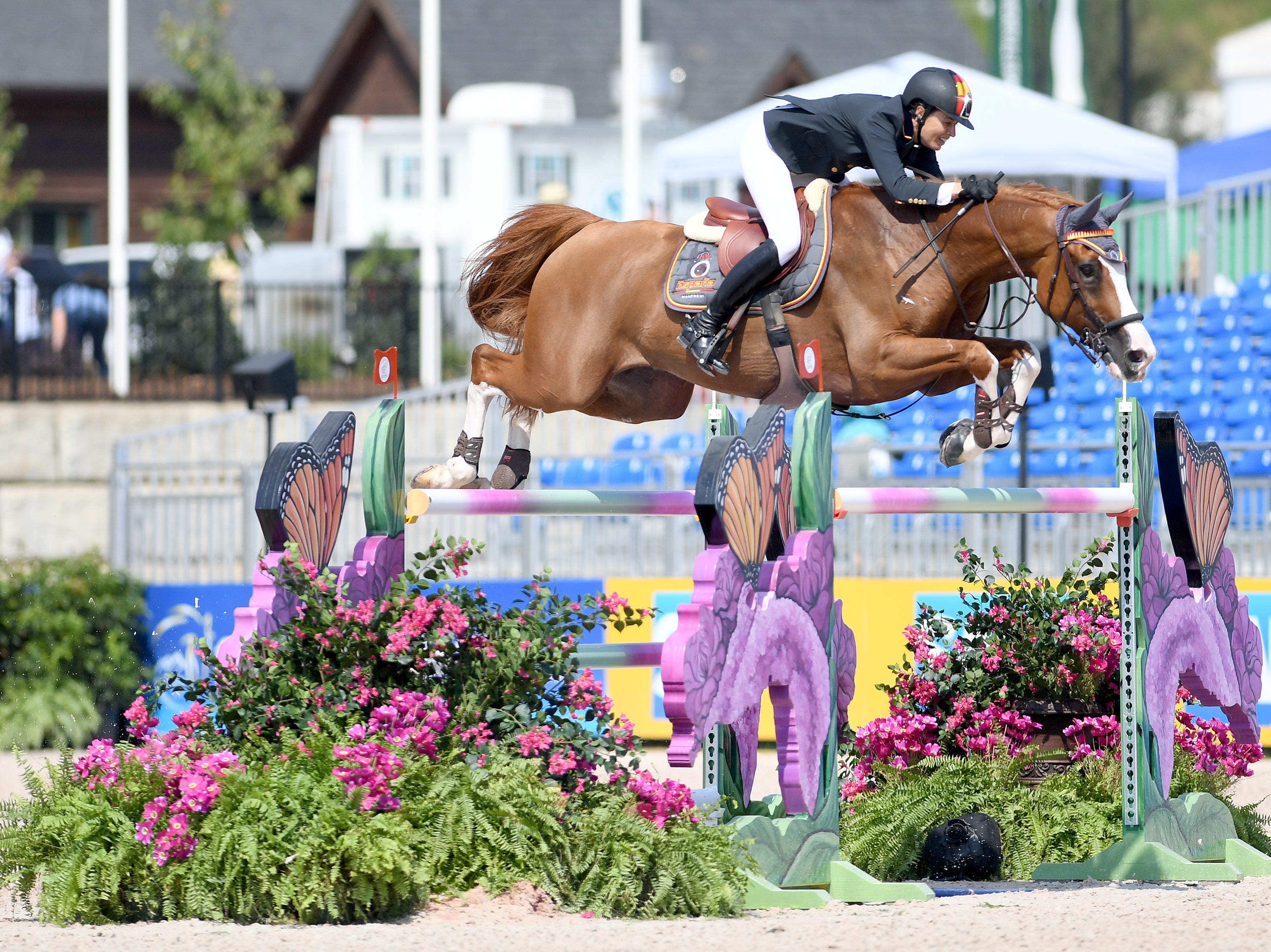 Spain's Pilar Lucrecia Cordon, on Grand Cru van de Rozenberg, competes in the team jumping competition of the FEI World Equestrian Games at the Tryon International Equestrian Center on Sept. 20, 2018.