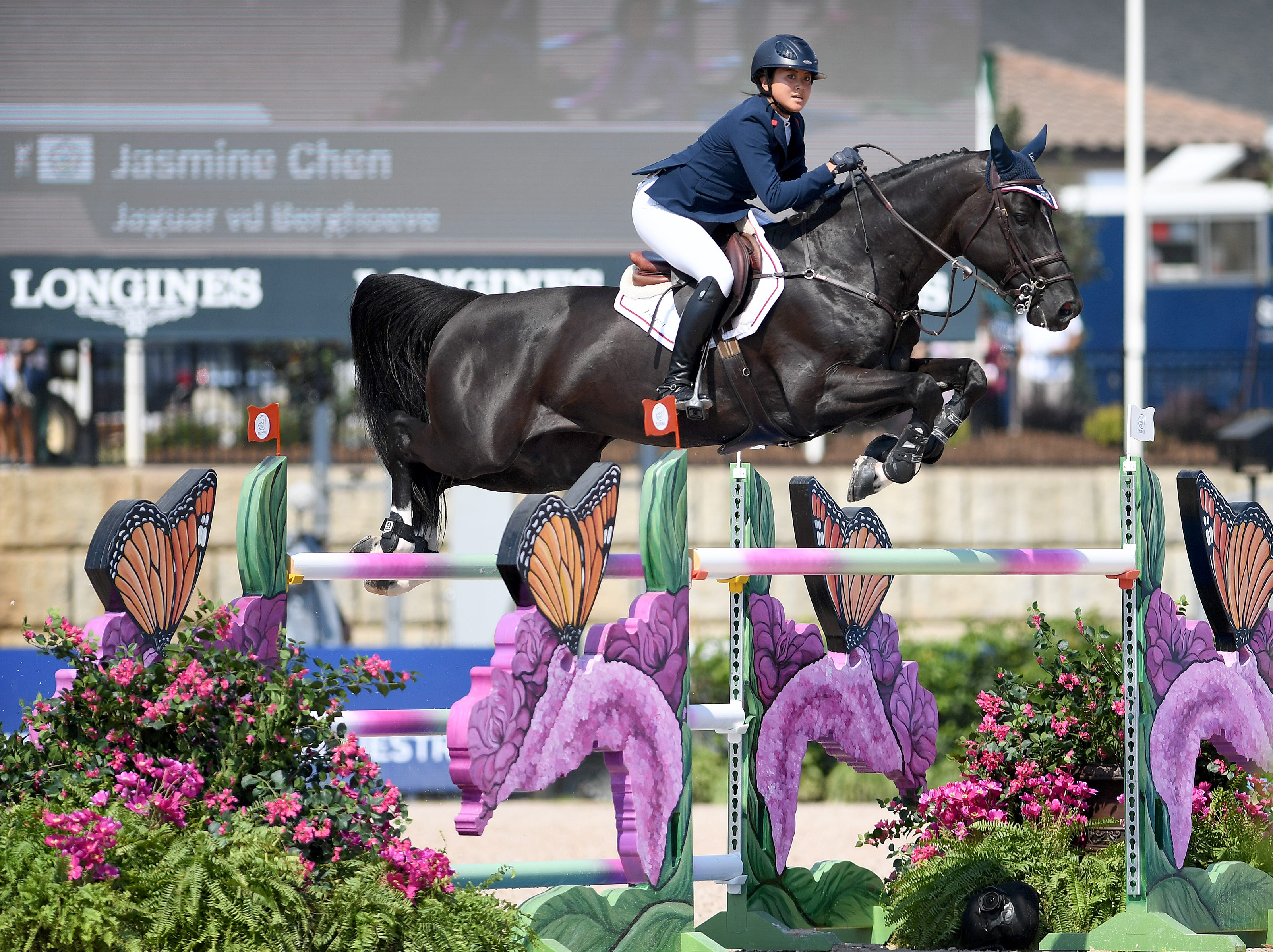 Taipei's Jasmine Chen, on Jaguar vd Berghoeve, competes in the team jumping competition of the FEI World Equestrian Games at the Tryon International Equestrian Center on Sept. 20, 2018.