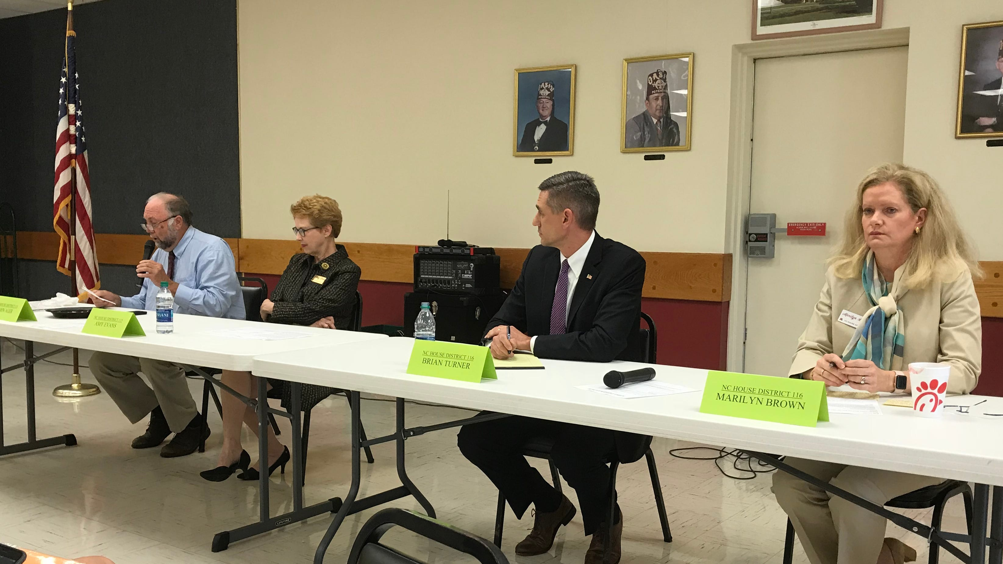 Rep. John Ager, left, makes a point while his opponent Amy Evans, to Ager's immediate right, listens during a debate Thursday. Other candidates speaking at the event  were Rep. Brian Turner and his challenger, Marilyn Brown.