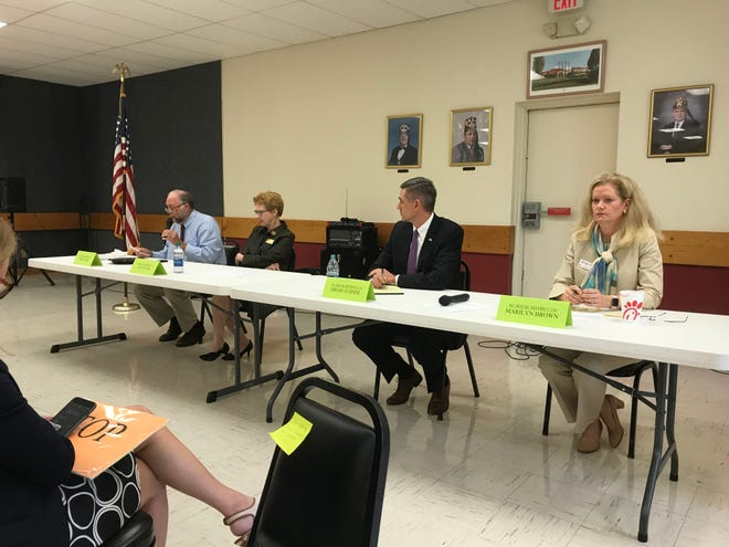 Rep. John Ager, left, makes a point while his opponent Amy Evans listens during a debate Thursday. Other candidates speaking at the event were Rep. Brian Turner and his challenger, Marilyn Brown.