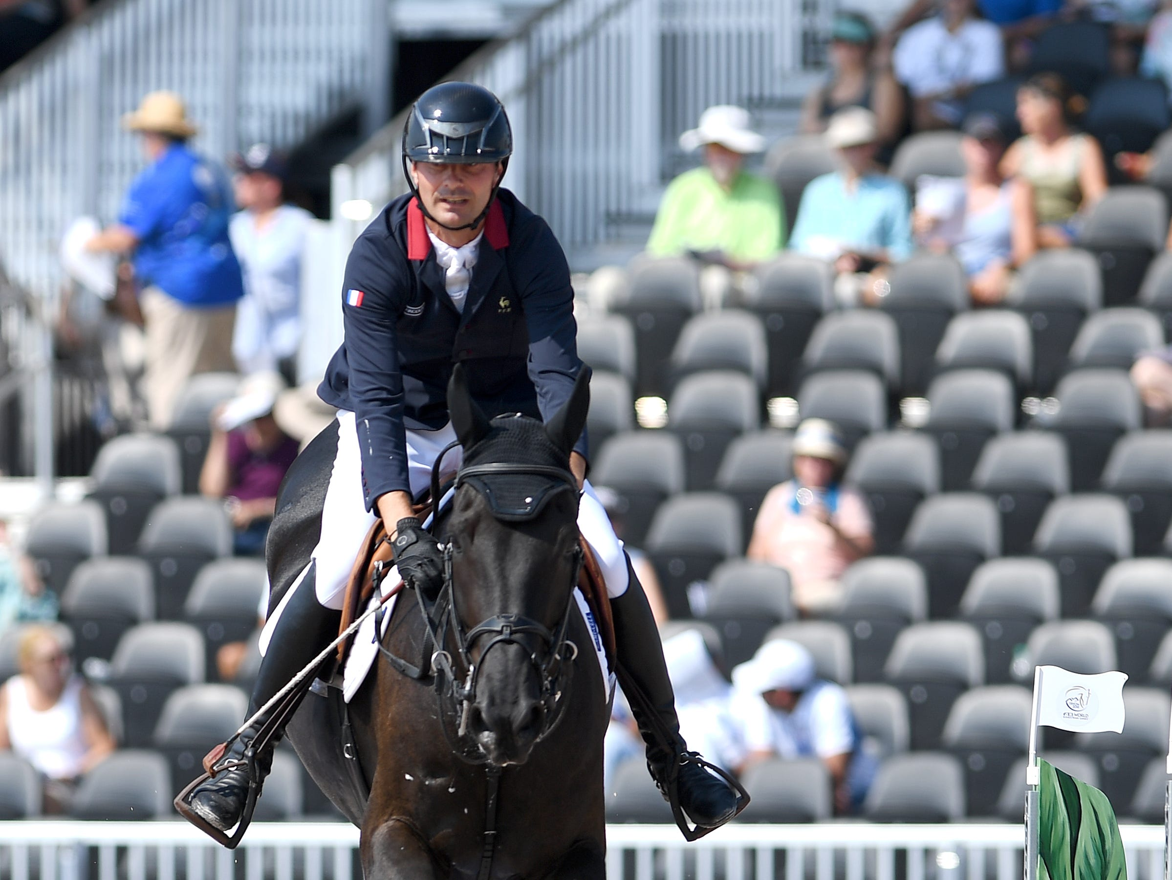 France's Nicolas Delmotte, on Ilex VP, competes in the team jumping competition of the FEI World Equestrian Games at the Tryon International Equestrian Center on Sept. 20, 2018.