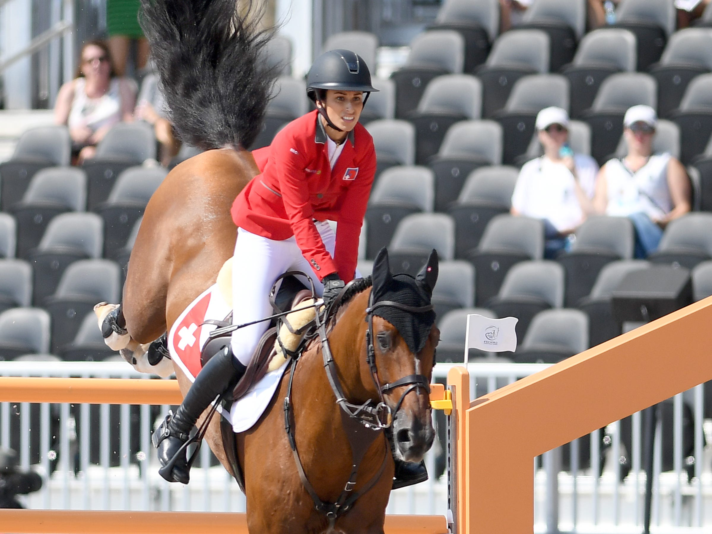 Switzerland's Janika Sprunger, on Bacardi VDL, competes in the team jumping competition of the FEI World Equestrian Games at the Tryon International Equestrian Center on Sept. 20, 2018.
