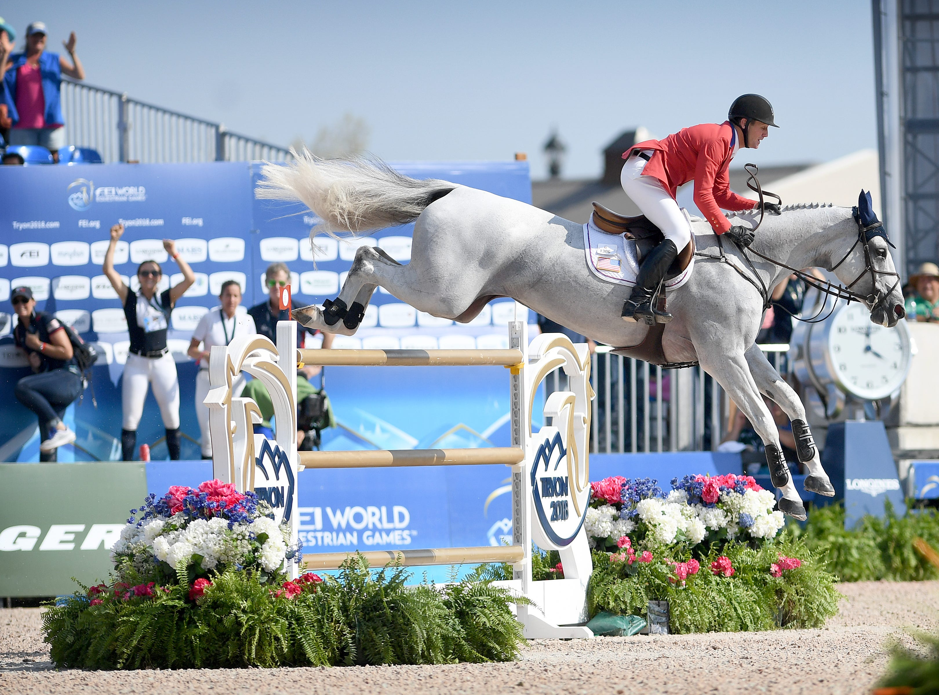 American McLain Ward leaps the final jump in the group jumping competition on horse, Clinta, during the FEI World Equestrian Games at the Tryon International Equestrian Center on Sept. 20, 2018.