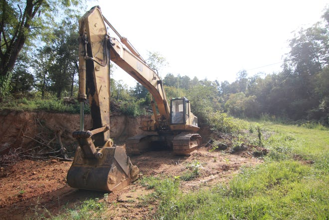 A 54-ton Caterpillar excavator sits idle, ready to move earth for the planned Deer Field development.