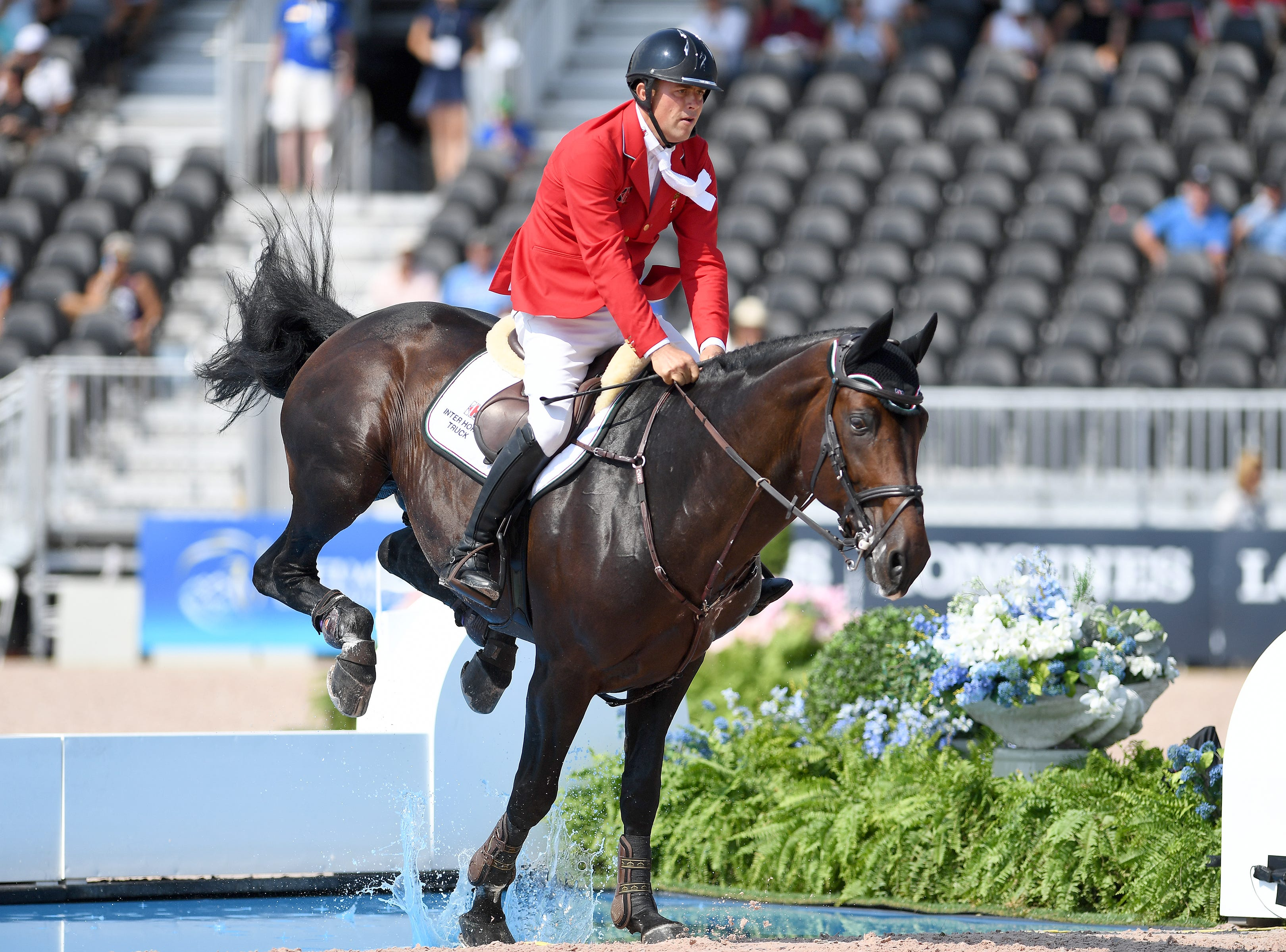 Hungary's Szabolcs Krucso, on Chacco Blue II, competes in the team jumping competition of the FEI World Equestrian Games at the Tryon International Equestrian Center on Sept. 20, 2018.