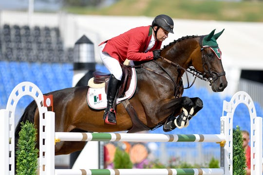 Mexico's Enrique Gonzalez, on Chacna, competes in the team jumping competition of the FEI World Equestrian Games at the Tryon International Equestrian Center on Sept. 20, 2018.