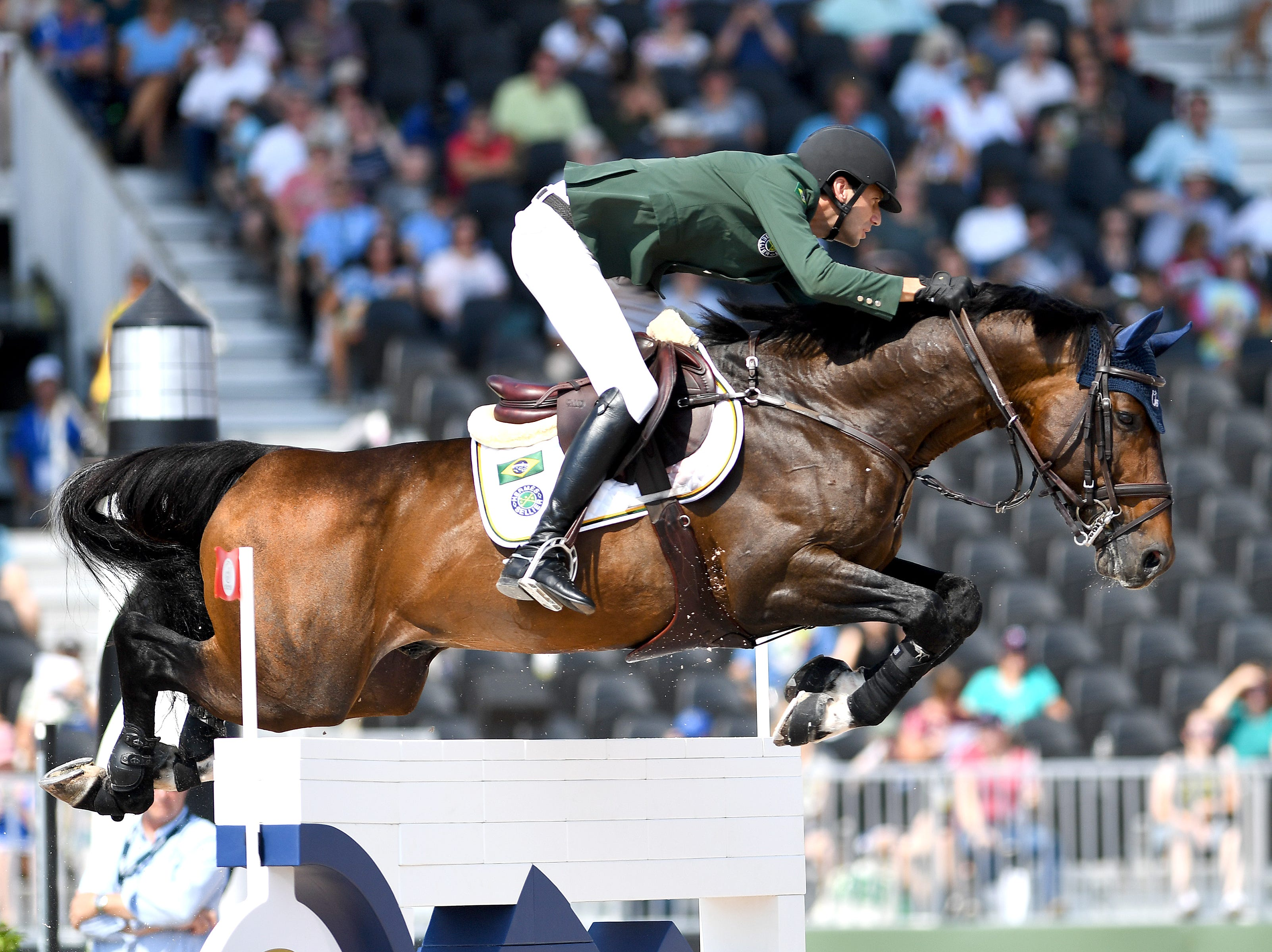 Brazil's Pedro Junqueira Muylaert, on Prince Royal Z MFS, competes in the team jumping competition of the FEI World Equestrian Games at the Tryon International Equestrian Center on Sept. 20, 2018.