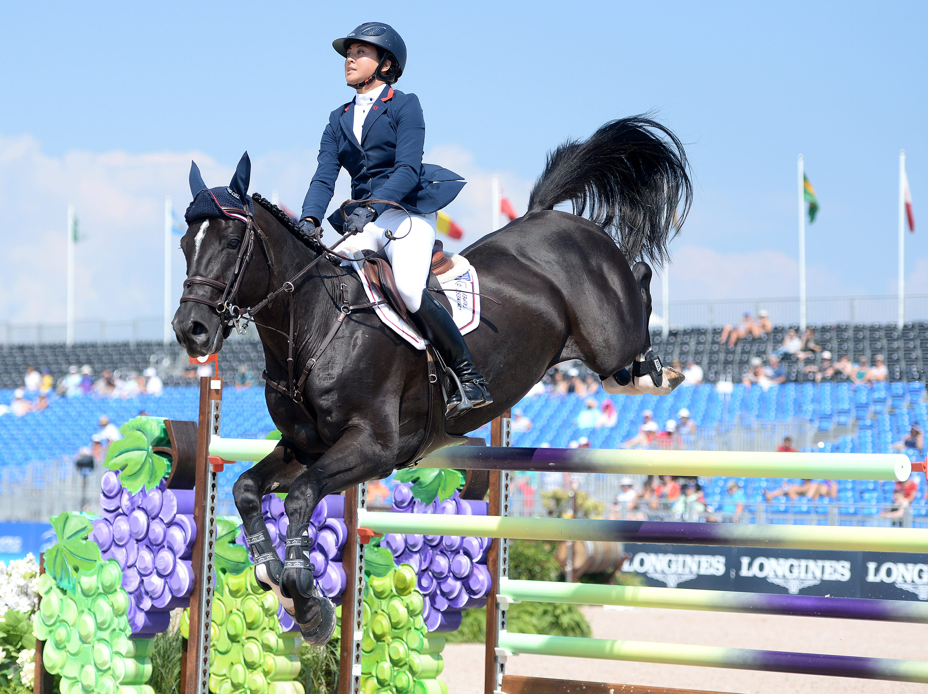 Jasmine Chen, of Taipei, on Jaguar vd Berghoeve, competes in the team jumping competition of the FEI World Equestrian Games at the Tryon International Equestrian Center on Sept. 20, 2018.