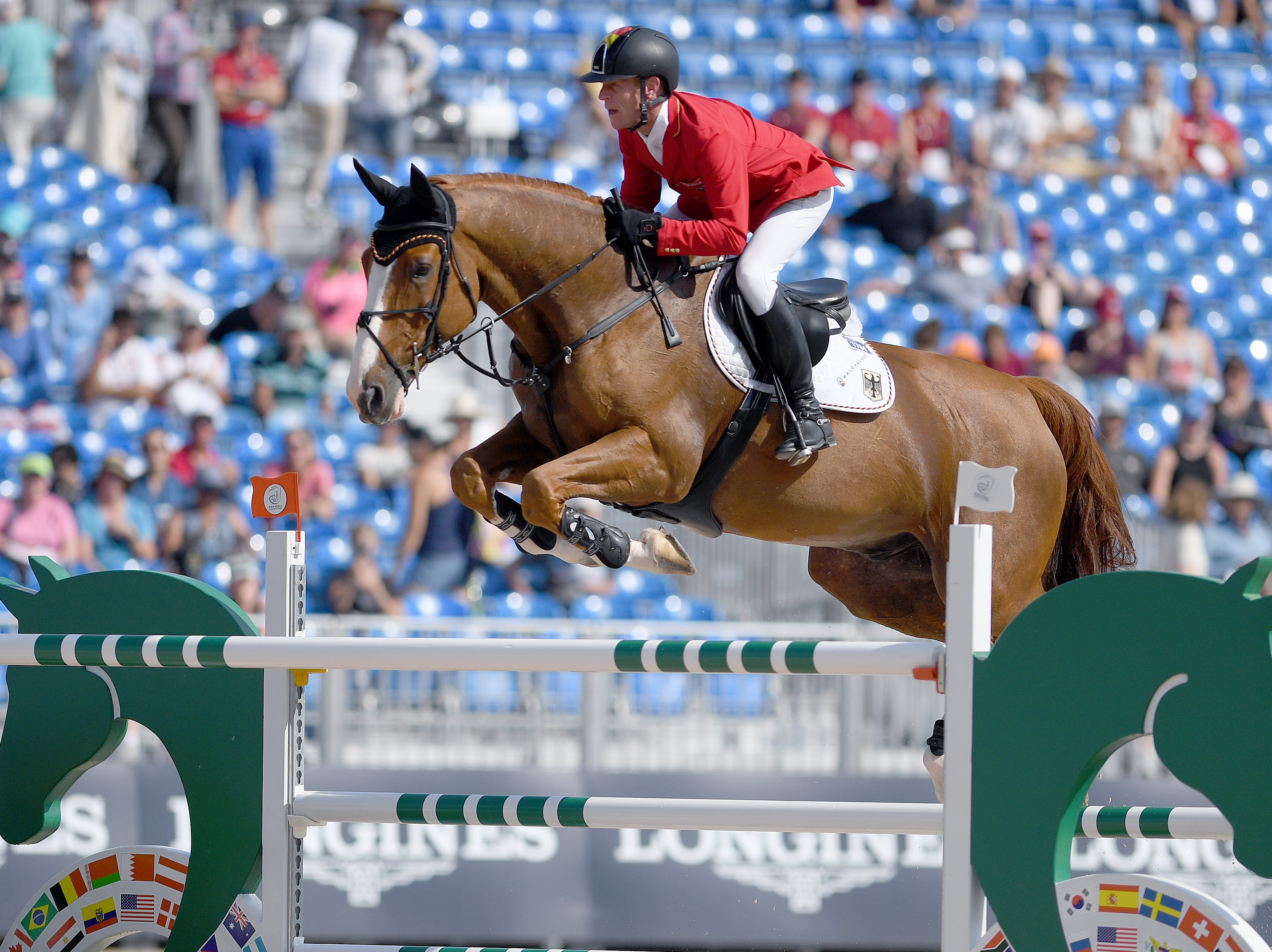 Germany's Marcus Ehning, on Pret A Tout, competes in the team jumping competition of the FEI World Equestrian Games at the Tryon International Equestrian Center on Sept. 20, 2018.
