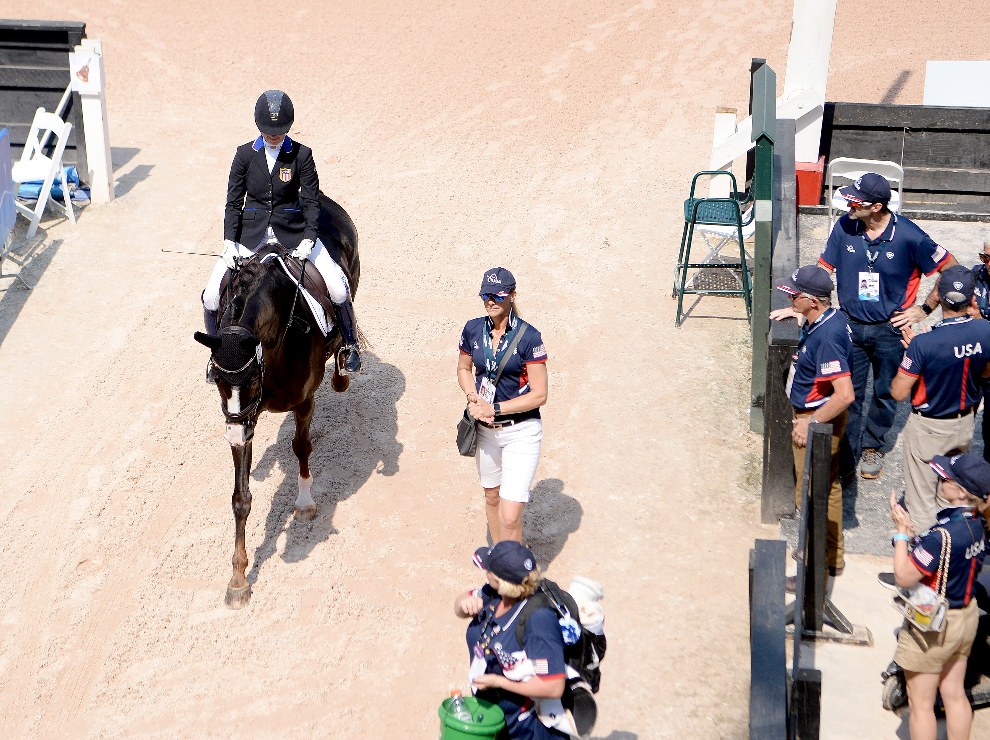 American Angela Peavy is applauded by teammates, trainers and supporters after her performance in the Para-dressage event of the FEI World Equestrian Games at the Tryon International Equestrian Center on Sept. 20, 2018.