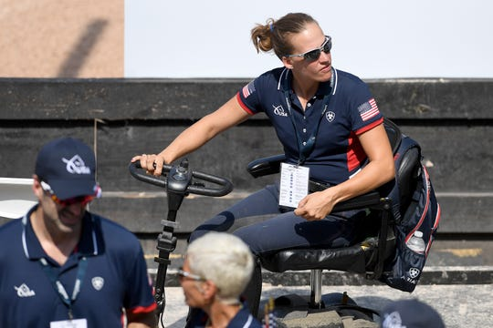 American Becca Hart arrives at her spot to watch teammate Angela Peavy perform in the Para-dressage event of the FEI World Equestrian Games at the Tryon International Equestrian Center on Sept. 20, 2018. Hart won a bronze medal in the para-dressage individual competition on Wednesday.
