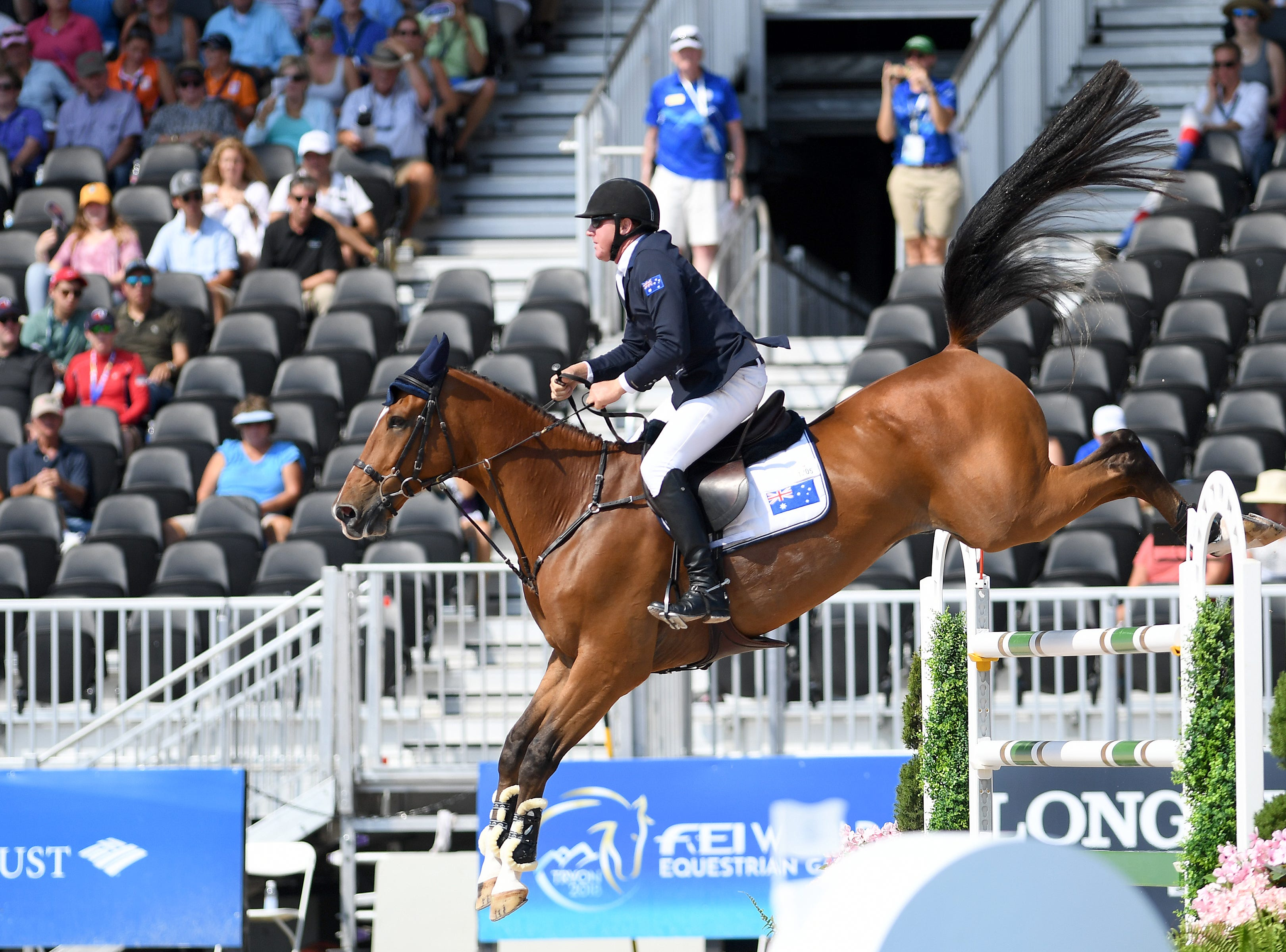 Australia's Scott Keach, on Fedor, competes in the team jumping competition of the FEI World Equestrian Games at the Tryon International Equestrian Center on Sept. 20, 2018.