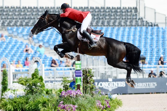 Belgium's Nicola Philippaerts rides H&M Chilli Willi during jumping competition at the World Equestrian Games Sept. 19, 2018.