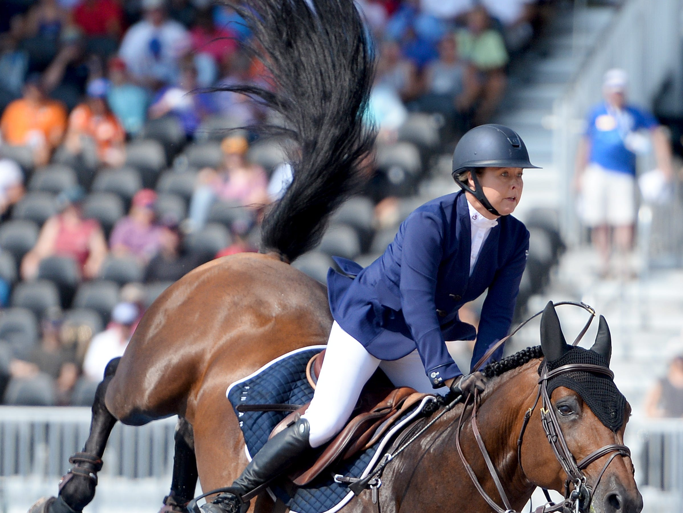 Finland's Juulia Jylas, on Finishing Touch Wareslage, competes in the team jumping competition of the FEI World Equestrian Games at the Tryon International Equestrian Center on Sept. 20, 2018.